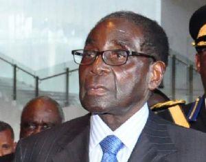 Mugabé contesté par-ci, adulé par là, aux commandes de l'UA